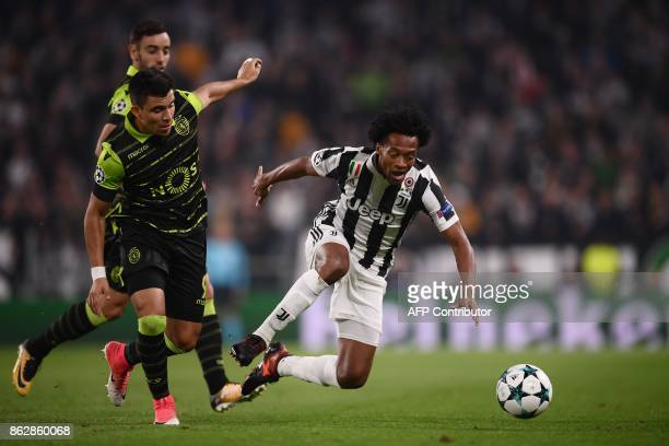 Juventus' forward from Colombia Juan Cuadrado vies with Sporting's Argentinian forward Marcos Acuna during the UEFA Champions League Group D football...