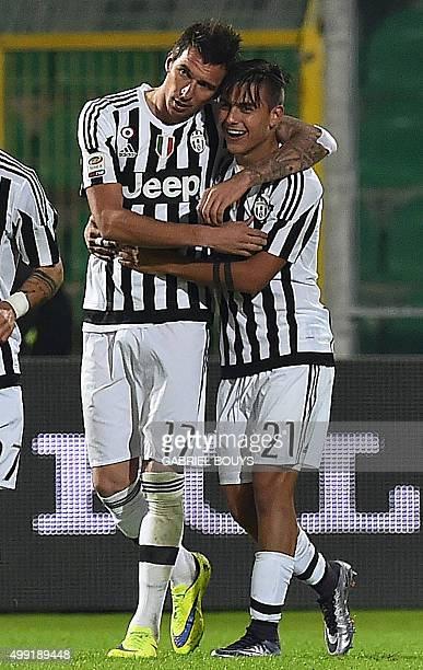 Juventus' forward from Croatia Mario Mandzukic celebrates his goal with Juventus' forward from Argentina Paulo Dybala during the Italian Serie A...