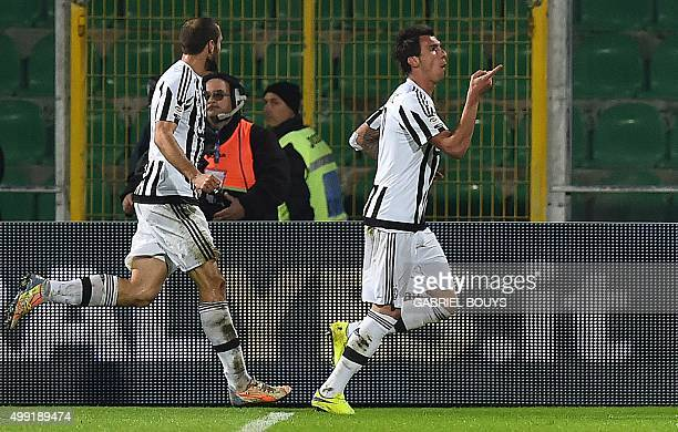 Juventus' forward from Croatia Mario Mandzukic celebrates his goal during the Italian Serie A football match between Palermo and Juventus on November...