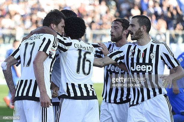 Juventus' forward from Croatia Mario Mandzukic celebrates Juventus' forward from Colombia Juan Cuadrado Juventus' midfielder from Italy Claudio...