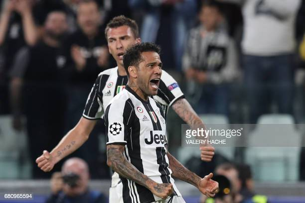 Juventus' forward from Croatia Mario Mandzukic celebrates with Juventus Defender from Brazil Dani Alves after scoring during the UEFA Champions...