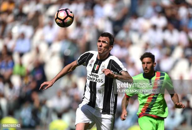 Juventus' forward from Croatia Mario Mandzukic eyes the ball during the Italian Serie A football match Juventus vs Crotone at the Juventus Stadium in...