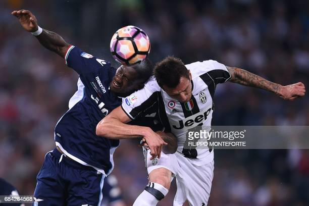 Juventus' forward from Croatia Mario Mandzukic fights for the ball with Lazio's defender from Angola Bastos during the Italian Tim Cup final on May...