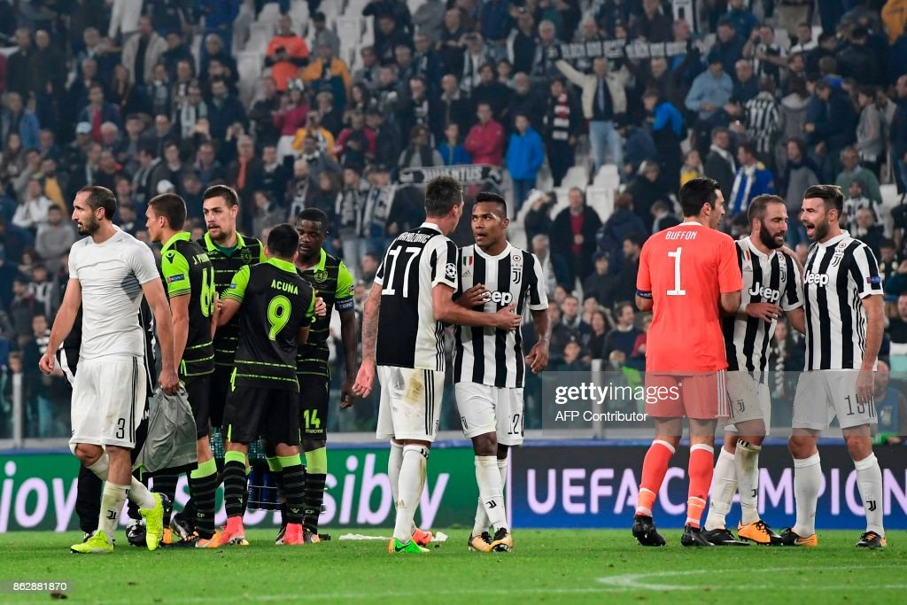 Juventus' forward from Croatia Mario Mandzukic (C), Juventus' defender from Brazil Alex Sandro (4thR), Juventus' goalkeeper from Italy Gianluigi Buffon (3rdR), Juventus' forward from Argentina Gonzalo Higuain (2ndR) and Juventus' defender from Italy Andrea Barzagli (R) celebrate at the end of the UEFA Champions League Group D football match Juventus vs Sporting CP at the Juventus stadium on October 17, 2017 in Turin. Juventus won 2-1. / AFP PHOTO / Miguel MEDINA