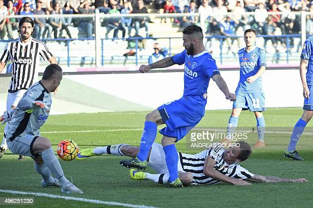 Juventus' forward from Croatia Mario Mandzukic kicks and scores during the Italian Serie A football match Empoli vs Juventus on November 8 2014 at...