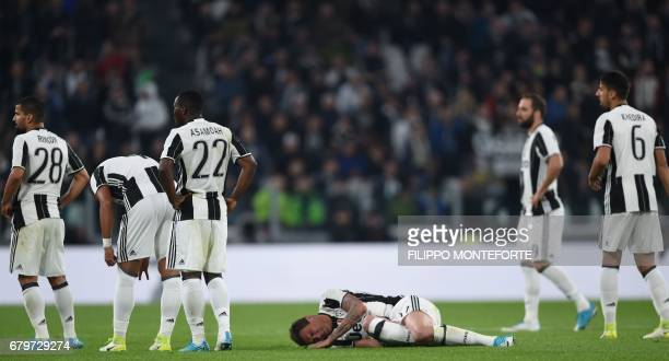 Juventus' forward from Croatia Mario Mandzukic lays on the ground after a tackle during the Italian Serie A football match Juventus vs Torino FC at...