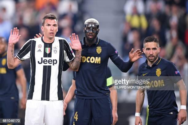 Juventus' forward from Croatia Mario Mandzukic Monaco's French midfielder Tiemoue Bakayoko and Monaco's Portuguese midfielder Joao Moutinho gesture...