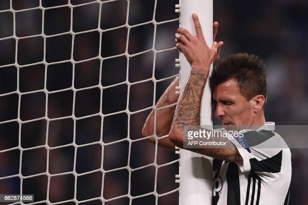 Juventus' forward from Croatia Mario Mandzukic reacts during the UEFA Champions League Group D football match Juventus vs Sporting CP at the Juventus...