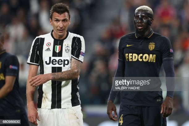 Juventus' forward from Croatia Mario Mandzukic reacts next to Monaco's French midfielder Tiemoue Bakayoko during the UEFA Champions League semi final...