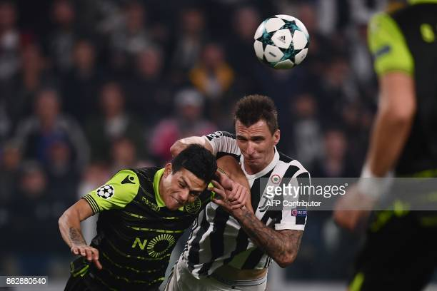 Juventus' forward from Croatia Mario Mandzukic scores despite Sporting's Argentinian defender Jonathan Silva during the UEFA Champions League Group D...