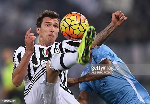 Juventus' forward from Croatia Mario Mandzukic vies for the ball with Lazio's forward from Netherlands Ricardo Kishna during the Italian Serie A...