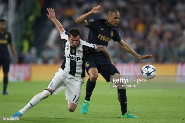 Juventus' forward from Croatia Mario Mandzukic vies with Monaco's Brazilian defender Fabinho during the UEFA Champions League semi final second leg...