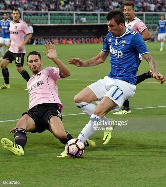 Juventus' forward from Croatia Mario Mandzukic vies with Palermo's defender from Italy Edoardo Goldaniga during the Italian Serie A football match...