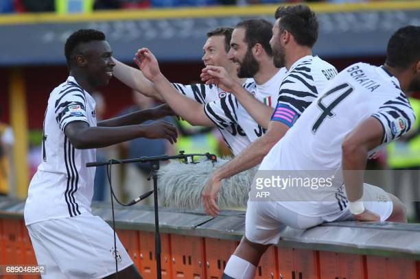 Juventus' forward from Italy Moise Kean celebrates with teammate after scoring during the Italian Serie A football match at the 'Renato Dall'ara'...