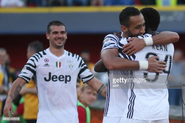 Juventus' forward from Italy Moise Kean celebrates with teammate Juventus' defender Medhi Benatia after scoring during the Italian Serie A football...