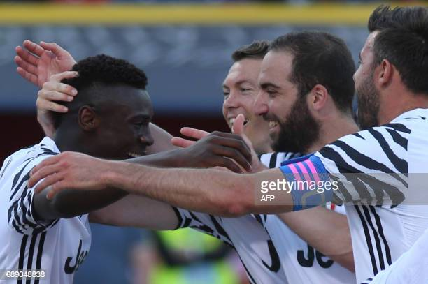 Juventus' forward from Italy Moise Kean celebrates with teammate Juventus' defender from Switzerland Stephan Lichtsteiner Juventus' forward from...