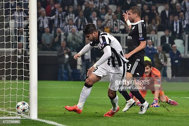 Juventus' forward from Spain Alvaro Morata scores during the UEFA Champions League semifinal first leg football match Juventus vs Real Madrid on May...