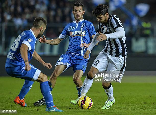 Juventus' forward from Spain Alvaro Morata vies with Empoli's midfielder Mirko Valdifiori and Empoli's defender Lorenzo Tonelli during the Italian...