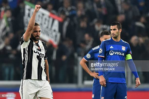 TOPSHOT Juventus' forward Gonzalo Higuain celebrates after scoring a penalty during the UEFA Champions League football match Juventus vs Olympique...
