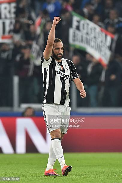 Juventus' forward Gonzalo Higuain celebrates after scoring a penalty during the UEFA Champions League football match Juventus vs Olympique Lyonnais...