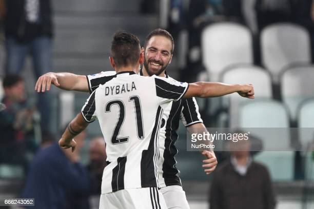 Juventus forward Gonzalo Higuain celebrates with Juventus forward Paulo Dybala after scoring his goal during the Serie A football match n31 JUVENTUS...