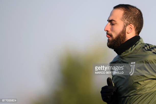 Juventus' forward Gonzalo Higuain from Argentina attends a training session on the eve of the UEFA Champions League football match Juventus Vs...