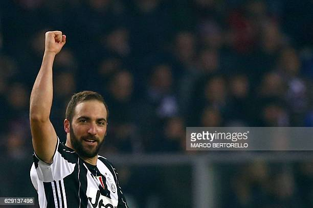 Juventus' forward Gonzalo Higuain from Argentina celebrates after scoring during the Italian Serie A football match Torino Vs Juventus on December 11...