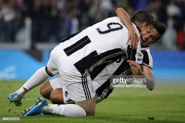 Juventus' forward Gonzalo Higuain from Argentina celebrates after scoring with his teammate Juventus' forward Paulo Dybala from Argentina during the...