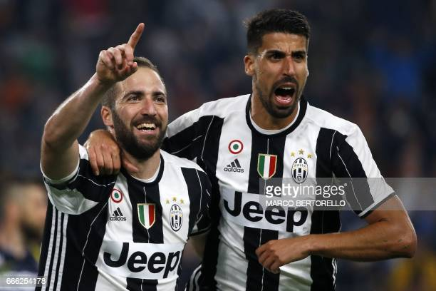Juventus' forward Gonzalo Higuain from Argentina celebrates after scoring with his teammate Juventus' midfielder Sami Khedira from Germany during the...