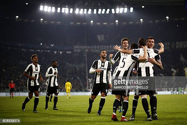 Juventus' forward Gonzalo Higuain from Argentina celebrates with teammates after scoring during the UEFA Champions League football match Juventus Vs...