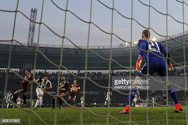 Juventus' forward Gonzalo Higuain from Argentina scores a goal during the Italian Serie A football match between Torino and Juventus on December 11...