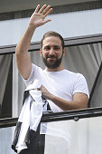 Juventus' forward Gonzalo Higuain from Argentina waves from the Juventus' headquarter in Turin on July 27 2016 In the most unlikely move of the Serie...