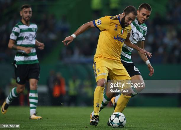 Juventus forward Gonzalo Higuain from Argentina with Sporting CP midfielder Joao Palhinha from Portugal in action during the UEFA Champions League...