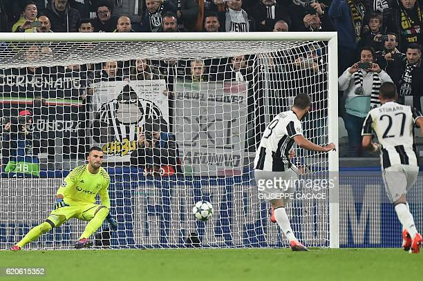 Juventus' forward Gonzalo Higuain kicks ans scores a penalty against Lyon's Portuguese goalkeeper Anthony Lopes during the UEFA Champions League...
