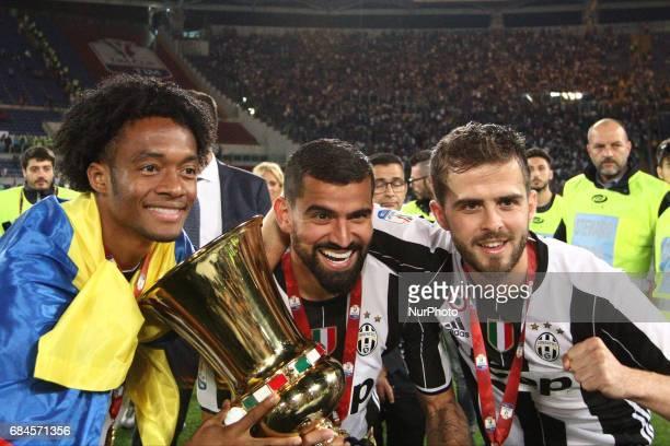 Juventus forward Juan Cuadrado Juventus midfielder Tomas Rincon and Juventus midfielder Miralem Pjanic celebrates victory after the Coppa Italia...