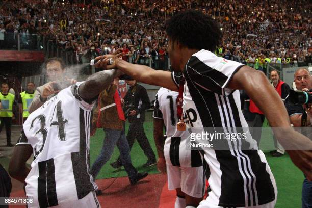 Juventus forward Juan Cuadrado plays with Juventus forward Bioty Moise Kean after the Coppa Italia final football match JUVENTUS LAZIO on at the...