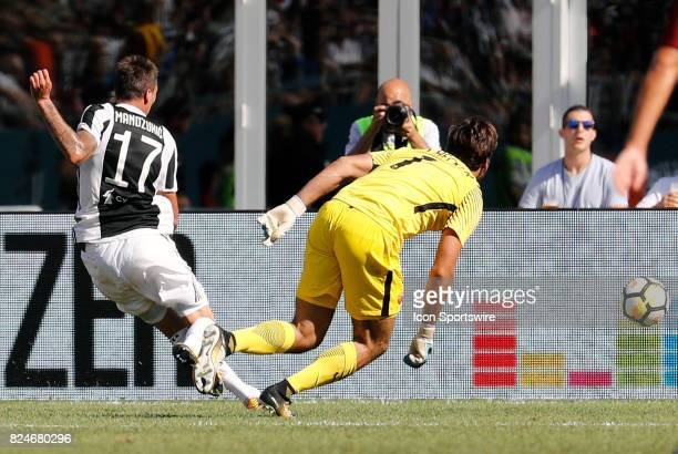 Juventus forward Mario Mandzukic beats Roma goalkeeper Alisson for the game's first goal during an International Champions Cup match between AS Roma...