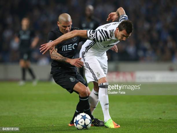Juventus forward Mario Mandzukic from Croacia with FC Porto's defender from Uruguay Maxi Pereira in action during the UEFA Champions League Round of...