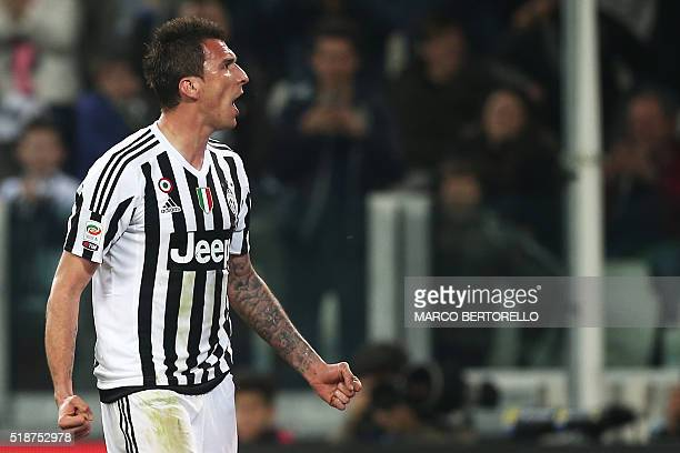 Juventus' forward Mario Mandzukic from Croatia celebrates after scoring during the Italian Serie A football match Juventus Vs Empoli on April 2 2016...