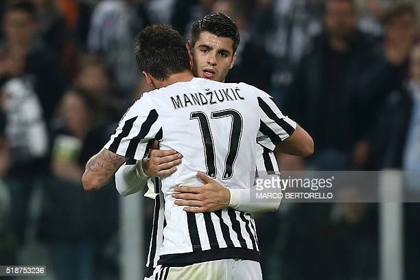 Juventus' forward Mario Mandzukic from Croatia celebrates after scoring with teammate Juventus' forward Alvaro Morata from Spain during the Italian...