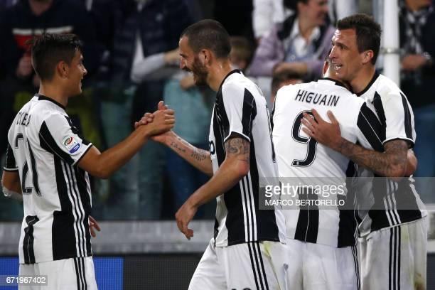 Juventus' forward Mario Mandzukic from Croatia celebrates with teammates Juventus' forward from Argentina Gonzalo Higuain Juventus' forward from...