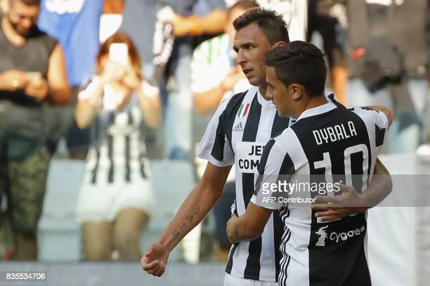Juventus' forward Mario Mandzukic from Croatia celebrates with Argentinian forward Paulo Dybala after scoring during the Italian Serie A football...