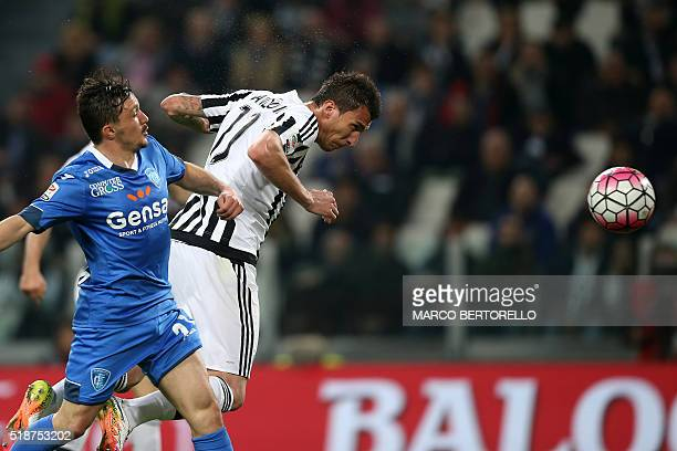 Juventus' forward Mario Mandzukic from Croatia scores during the Italian Serie A football match Juventus Vs Empoli on April 2 2016 at the 'Juventus...