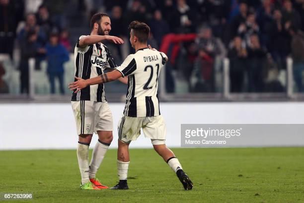 Juventus' forward Paulo Dybala celebrates after scoring a goal with Juventus' forward Gonzalo Higuain during the Serie A match between Juventus FC...