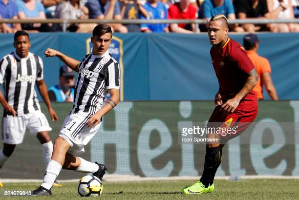 Juventus forward Paulo Dybala cuts away from Roma midfielder Radja Nainggolan during an International Champions Cup match between AS Roma and...