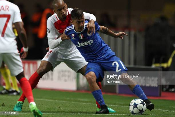 Juventus forward Paulo Dybala fights for the ball against Monaco defender Fabinho during the Uefa Champions League semi finals football match MONACO...