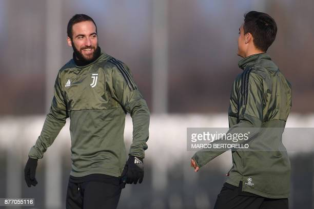 Juventus' forward Paulo Dybala from Argentina and Juventus' forward Gonzalo Higuain from Argentina attend a training session on the eve of the UEFA...