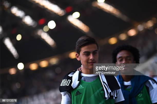 Juventus' forward Paulo Dybala from Argentina and teammate Juan Guillermo Cuadrado are pictured before the Italian Serie A football match Juventus Vs...