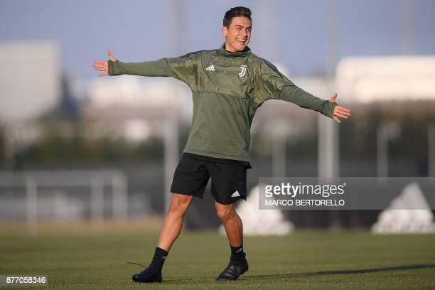 Juventus' forward Paulo Dybala from Argentina attends a training session on the eve of the UEFA Champions League football match Juventus Vs Barcelona...