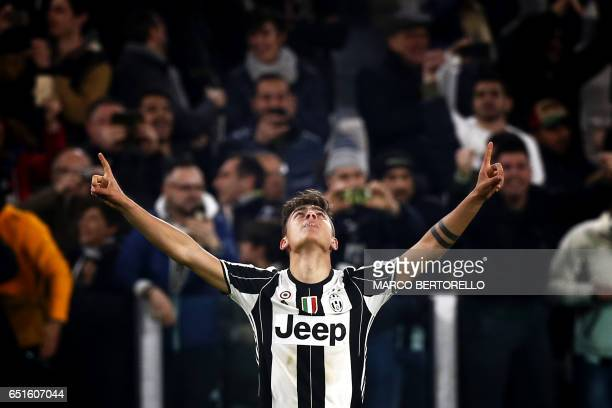 Juventus' forward Paulo Dybala from Argentina celebrates after scoring during the Italian Serie A football match Juventus Vs AC Milan on March 10...